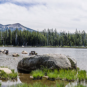 Peaks of Desolation Wilderness rise in the background of this lake panorama at Wrights Lake Recreation Area, Eldorado National Forest, California, USA. Directions to Wrights Lake Campground: 23 miles east of Placerville on Highway 50, 11 miles north on Ice House Road (Forest Road<br /> 3), 9 miles east on Forest Road 32 (Wrights Lake Tie Road), and 2 miles north on Forest Road 4 (Wrights<br /> Lake Rd). This panorama was stitched from 9 overlapping photos.