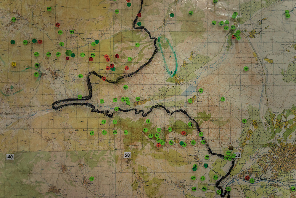 STEPANAKERT, NAGORNO-KARABAKH - APRIL 20: A map showing the locations of already cleared minefields, marked in green, and minefields yet to be cleared, marked in red, at the offices of the charity HALO Trust on April 20, 2015 in Stepanakert, Nagorno-Karabakh. Since signing a ceasefire in a war with Azerbaijan in 1994, Nagorno-Karabakh, officially part of Azerbaijan, has functioned as a self-declared independent republic and de facto part of Armenia, with hostilities along the line of contact between Nagorno-Karabakh and Azerbaijan occasionally flaring up and causing casualties. (Photo by Brendan Hoffman/Getty Images) *** Local Caption ***