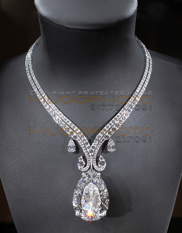 The 68 carat Taylor-Burton Diamond photographed on a grey bust.