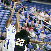 Delaware Sophomore Forward (#12) Danielle Parker takes the jump shot scoring 2 of her 8 points during VCU delaware game at the The Bob Carpenter Center In Newark Delaware Thursday Night.