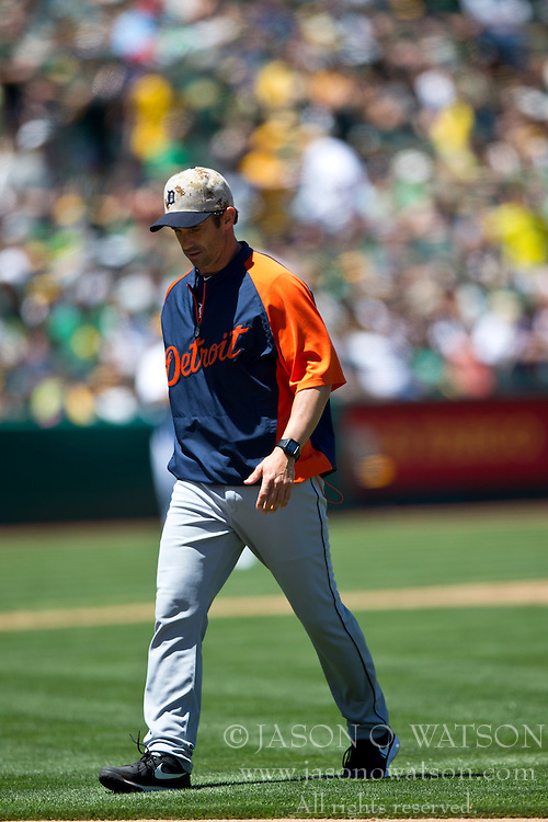 OAKLAND, CA - MAY 26:  Brad Ausmus #7 of the Detroit Tigers returns to the dugout after visiting the pitchers mound during the third inning against the Oakland Athletics at O.co Coliseum on May 26, 2014 in Oakland, California. The Oakland Athletics defeated the Detroit Tigers 10-0.  (Photo by Jason O. Watson/Getty Images) *** Local Caption *** Brad Ausmus