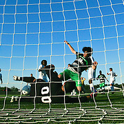 Goldey-Beacom Keeper Ignacio Farias (00) blocks Wilmington University forward Shaheen Rahmani (20) shot attempt in front of the net during a NCAA regular season match against Wilmington University  Wednesday, Sept. 12, 2012. at Kirkwood Soccer Complex...Special to Monsterphoto/SAQUAN STIMPSON