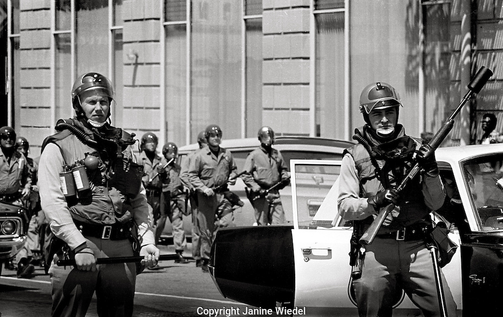 US National guard with teargas canister and shotgun  People's Park Student protest & riots in Berkeley California 1969