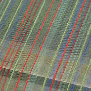 A gossamer woven natural Silk on the Loom at a Silk factory in ChangMai, Northern Thailand.