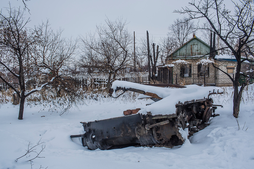 LUTUHYNE, UKRAINE - DECEMBER 8, 2014: A destroyed tank lies near a cluster of houses in Lutuhyne, Ukraine. CREDIT: Brendan Hoffman for The New York Times
