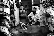 A man suffering with HIV is well enough to be offered his own accomodation, along with a friend, his pet puppy. Wat Prah Bat Nam Phu hospice, Lop Buri.  September 2003.©David Dare Parker / AsiaWorks Photography