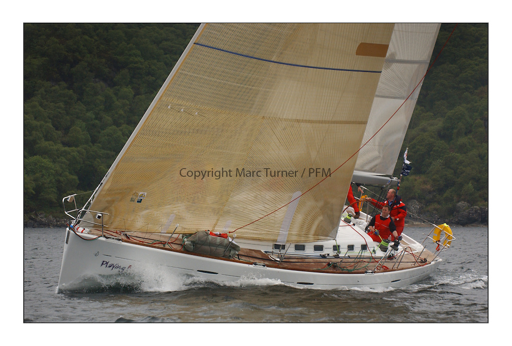 Yachting- The last days racing  of the Bell Lawrie Scottish series 2003 at Tarbert Loch Fyne.  Damp grey skies and light winds decided the final results in most fleets...Jonathan Anderson's Playing F$TE a First 47.7 in Class One...Pics Marc Turner / PFM