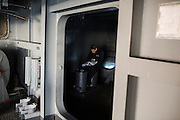 A crew member studies in a quiet corner of the fantail, the rear of the ship<br /> <br /> Aboard the USS Harry S. Truman operating in the Persian Gulf. February 25, 2016.<br /> <br /> Matt Lutton / Boreal Collective for Mashable