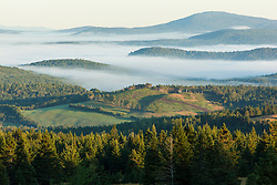 Fog in the Connecticut River Valley as seen from a hilltop farm in Stewartstown, New Hampshire. McAllaster Farm.