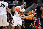 SHOT 1/21/12 6:54:15 PM - Colorado's Andre Roberson #21 looks to drive on an Arizona player during their PAC 12 regular season men's basketball game at the Coors Events Center in Boulder, Co. Colorado won the game 64-63..(Photo by Marc Piscotty / © 2012)