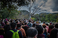 Bus loads of foreign tourists, the majority from China, converge at a view point at Kinkaku-ji, the Golden Pavillion.  Kyoto, Japan.  A decade ago, in winter, visitors would be in the single digits.<br /> <br /> Tourism brings in much needed yen, but it also presents the new challenge of crowd control.