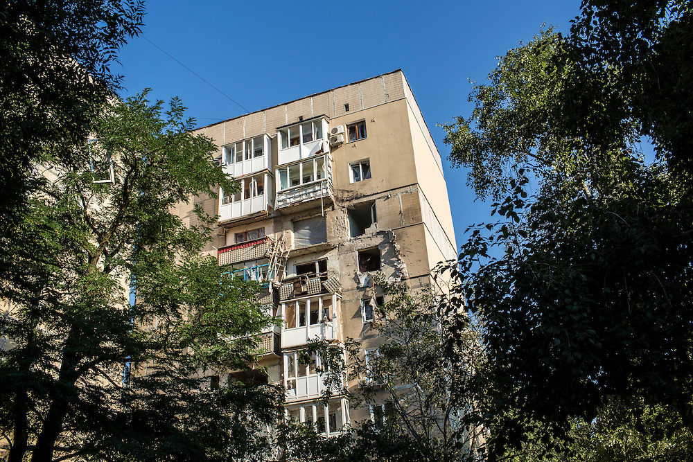 An apartment building which was hit by a suspected grad rocket strike on Tuesday, July 29, 2014 in Donetsk, Ukraine.