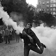 An Egyptian protestor hurls a tear gas canister back towards the police who shot it during ongoing demonstrations November 20, 2011 near Tahrir square in central Cairo, Egypt.  Protestors demanding the transition of power from military to civilian control clashed with Egyptian security forces for a second straight day in central Cairo, with hundreds injured and at least 11 protestors killed.  (Photo by Scott Nelson)