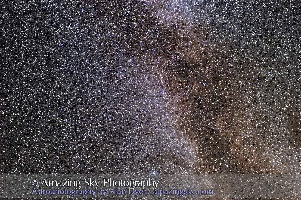 Milky Way area from Altair to Albireo, including Sagitta and Delphinus, and Coathanger. Taken Sept. 12, 2007 for stack of 4 x 5 minute exposures with 35mm L-series lens at f/2.8 and Canon 20Da camera at ISO 400.