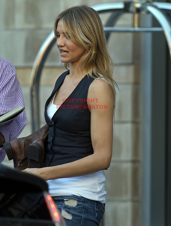 "(09/14/09-Boston,MA) Cameron Diaz walks with boots in hand one day before the start of filming of ""Wichita"", a movie she and Tom Cruise will star in.. She was seen here on Boylston Street. Staff photo by Mark Garfinkel"