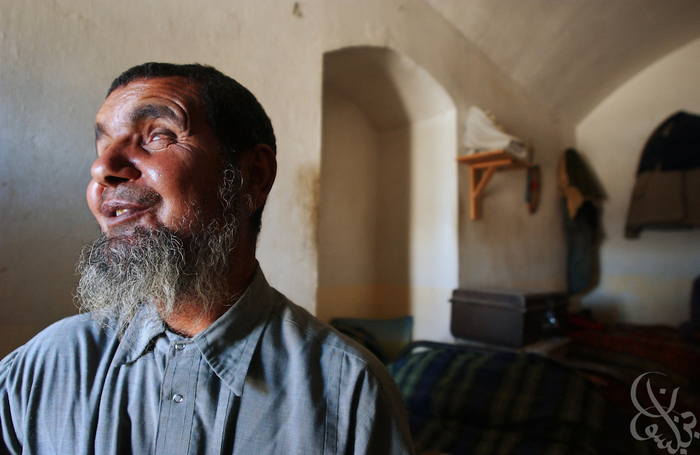 A blind Afghan man who declined to give his name passes time in the blind ward of the Afghanistan Red Crescent Society May 16, 2002 in Kandahar. The man has resided at the Society for approximately 35 years. Six others are in the ward as well.