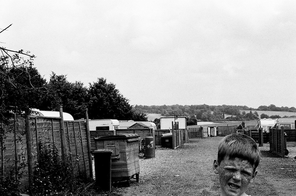Irish Traveller boy living on the Cow Roast illegal Irish Travellers site, near Tring (Hertfordshire), a few days before the 20 Irish Travellers families were evicted in July 2003.