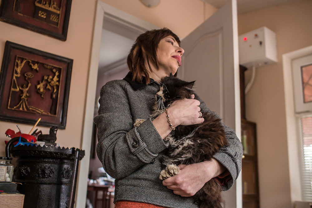 ODESSA, UKRAINE - MARCH 26, 2015: Ludmilla Khersonskaya, wife of poet Boris Khersonsky, with one of their cats at their in Odessa, Ukraine. CREDIT: Brendan Hoffman for The New York Times