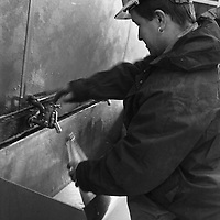 MINER FILLS HIS WATER BOTTLE IN PREPARATION FOR HIS TEN HOURS SHIFT UNDERGROUND AT LONGANNET COLLIERY, CULROSS. SCOTLAND, APRIL, 2001...