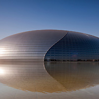 China, Beijing, Morning sunlight lights National Centre for the Performing Arts building, also known as The Egg, designed by architect Paul Andreu, on spring morning