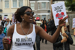 Tottenham, London, August 4th 2015. Family, friends and supporters of alleged gangster Mark Duggan, who was shot and killed by police on 4th August 2011 in Tottenham, commemorate his death which led to widespread uprisings and riots, by marching from Broadwater Farm estate to Tottenham police station. His family is demanding a public inquiry into the role of Operation Trident, set up to fight gun and knife crime amongst the black community, whose officers they accuse of putting guns out on the streets of London. PICTURED:  // Contact: paul@pauldaveycreative.co.uk Mobile 07966 016 296
