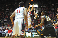 "Mississippi's Marshall Henderson (22) shoots vs. Missouri's Jabari Brown (32) at the C.M. ""Tad"" Smith Coliseum in Oxford, Miss. on Saturday, February 8, 2014. Henderson made 8 three pointers during the game."