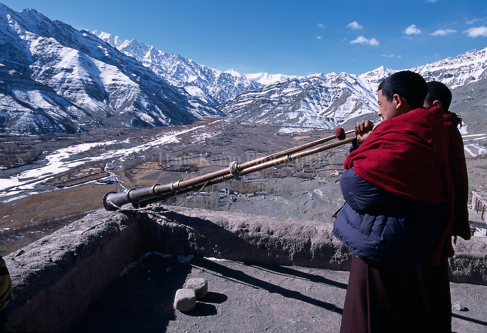 Monks sound the horns from the roof of Matho Monastery in Ladakh, announcing the start of a religious festival.