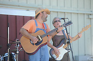 "Luke Fisher (left) and Amy Fisher play music during St. Peter's Episcopal Church's ""Fun in the Country"" in Oxford, Miss. on Monday, September 6, 2010."