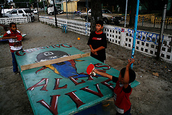 Young boys play ping-pong on a table provided by Alexis Vive collective in the 23 de Enero barrio.