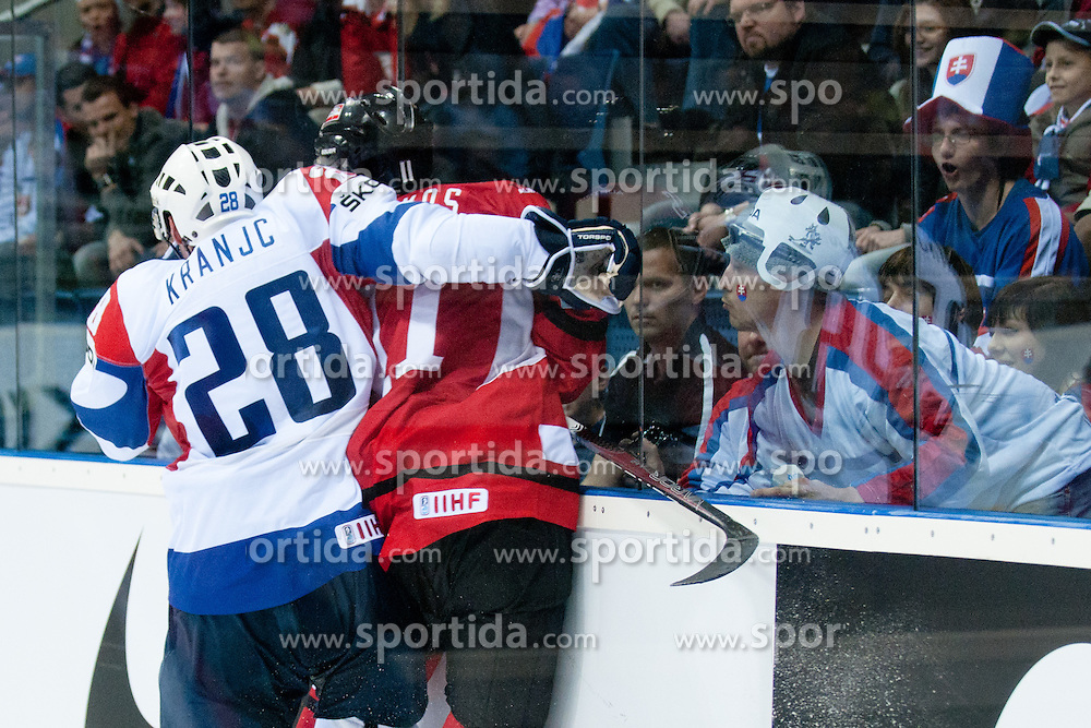 Ales Kranjc of Slovenia vs Philippe Lakos of Austria during the ice-hockey match between Austria and Slovenia of Group G in Relegation Round of IIHF 2011 World Championship Slovakia, on May 7, 2011 in Orange Arena, Bratislava, Slovakia (Photo by Matic Klansek Velej / Sportida)