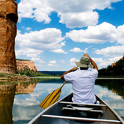 Alfred Acevedo paddles a canoe at Ramah Lake near Ramah, New Mexico.
