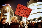Frankfurt am Main | 09 Feb 2015<br /> <br /> Am Montag (09.02.2015) demonstrierte bereits zum dritten Mal die islamfeindliche und rassistische Gruppierung PEGIDA (Patrioden gegen die Islamisierung des Abendlandes) unter F&uuml;hrung der Frankfurterin Heidi Mund und in Gegenwart des Neonazis und Vorsitzenden der NPD Hessen, Stefan Jagsch, an der Katharinenkirche in Frankfurt am Main, PEGIDA konnte etwa 100 Demonstranten mobilisieren. An den Gegendemos nahmen etwa 1000 Menschen teil.<br /> Hier: Gegendemonstranten mit einem Transparent mit der Aufschrift &quot;Schei&szlig;verein&quot;.<br /> <br /> &copy;peter-juelich.com<br /> <br /> [No Model Release | No Property Release]