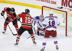 Feb 9, 2009; Newark, NJ, USA; New Jersey Devils left wing Zach Parise (9) scores a goal during the second period at the Prudential Center.