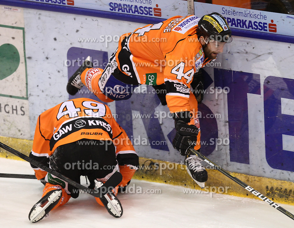 19.02.2013, Eisstadion Liebenau, Graz, AUT, EBEL, Graz 99ers vs UPC Vienna Capitals, 9. Platzierungsrunde, im Bild Greg Day (Graz 99ers, #49) und Olivier Latendresse, (99ers, #44)// during the Erste Bank Icehockey League 9th Placement round match betweeen Graz 99ers and UPC Vienna Capitals at the Icehockey Stadium Liebenau, Graz, Austria on 2013/02/19. EXPA Pictures © 2013, PhotoCredit: EXPA/ Patrick Leuk