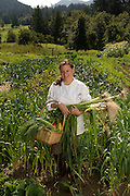 Mara Jernigan, of Fairburn Farm culinary retreat and guestouse, collects fresh produce from her garden in preparation for dinner