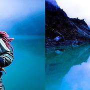 Peruvian mountain guide Renzo Moreno poses for photos standing in front of the Ocshapalca snow capped mountain in the White mountain range near Huaraz, Peru, Friday, Jan. 14, 2011.(Photo Dado Galdieri)