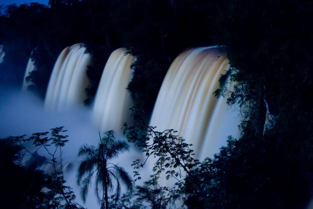 Cataracts of Iguazu Falls illuminated by full moonlight, Iguazu National Park, Argentina, South America