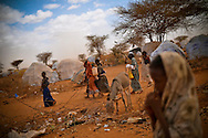 Girls carry water at the Ifo extension refugee camp in Dadaab, Kenya. Forty percent of newly arrived refugees surveyed by Internews said they need more information about how to access water.