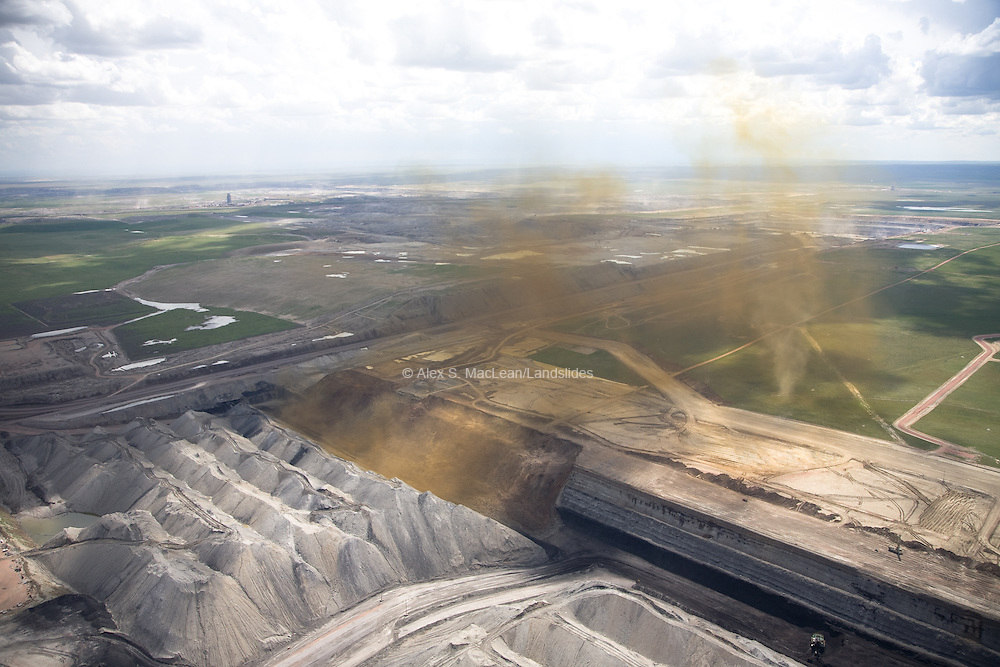 Coal strip mining in the Powder River Basin. Strip mining is a type of surface mining that involves excavating earth and rock to uncover a layered mineral reserve. The excavation of the overburden (overlying material) is completed in rectangular blocks in pits or strips.