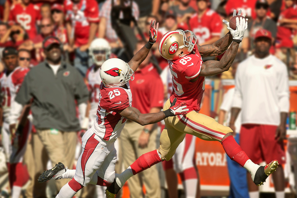 SAN FRANCISCO, CA - October 13 Vernon Davis #85 of the San Francisco 49ers makes a catch during the game against the Arizona Cardinals at Candlestick Park on October 13, 2013 in San Francisco, California. The 49ers defeated the Cardinal 32-20. (Photo by Jean Fruth/San Francisco 49ers