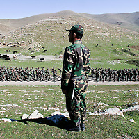 An officer looks on as Iraqi Kurdish Peshmerga's, part of an Iraqi Anti-Terror Brigade based around the Kurdish capital of Suleimaniya, train at the Saraw (military) Camp outside of the city of Halabja in northern Iraq. Kurds swept into second place in Iraq's historic elections, well-placed to secure a major parliamentary presence and top government jobs after decades of struggle against successive Sunni regimes. February 2005.
