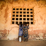 Girls look into the window of a classroom at the Idrissa Diouf primary school in Bignona, Senegal, on Tuesday June 12, 2007.