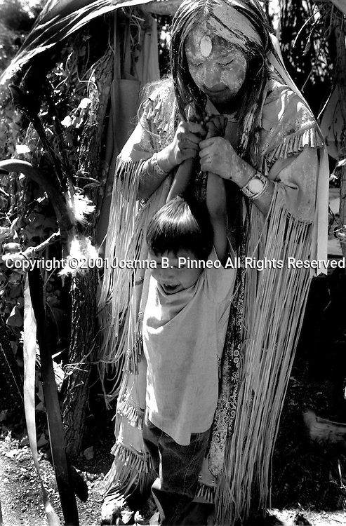 Along with healing powers that are said to last for four days, tradition calls for the Apache girl to stretch the children so they can grow tall and strong. From the collection of Grrlstories (www.grrlstories.org) a project that explores the ways girls come of age in America.