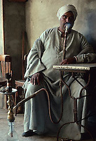 December 1993, Al Fayyum, Egypt --- Man Smoking a Hookah Water Pipe --- Image by © Owen Franken/CORBIS