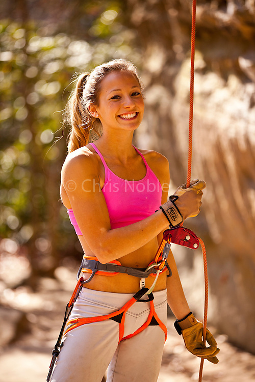 "Sasha DiGiulian belaying a friend climbing at the ""Solar Collector Wall"" Pendergrass Murray Recreational Preserve, Red River Gorge, Kentucky, USA."