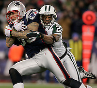 New England Patriots tight end Aaron Hernandez is tackled by New York Jets cornerback Dwight Lowery on a 15-yard reception in the third quarter at Gillette Stadium in Foxboro, Massachusetts on December 6, 2010.  The Patriots defeated the Jets 45-3.    UPI/Matthew Healey