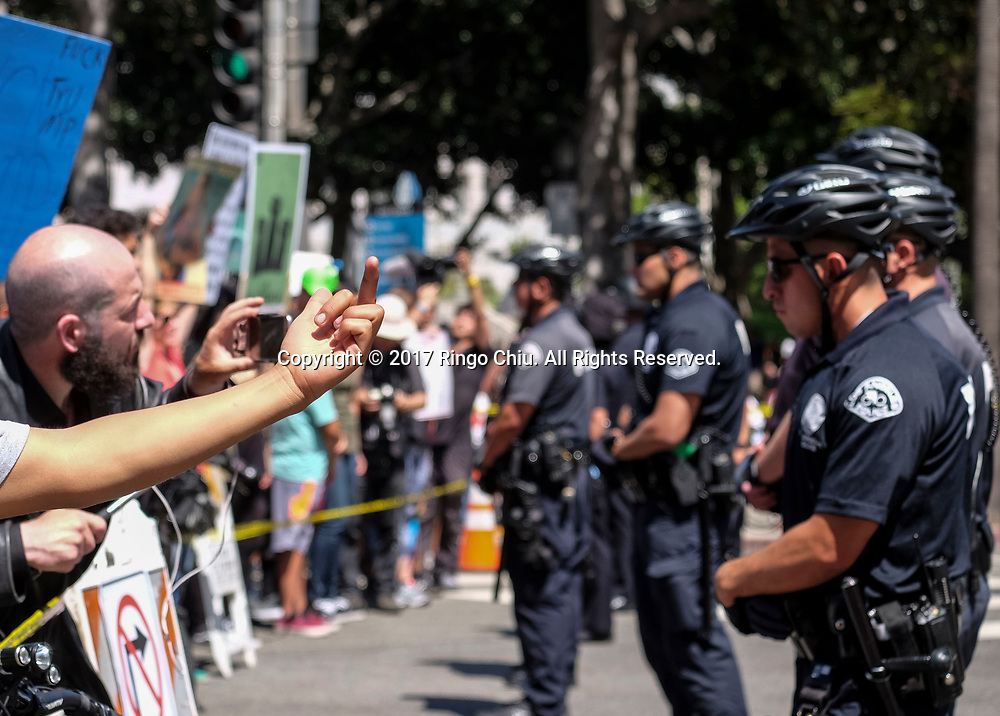 Police officers separate the May Day protesters, left, and a group of President Donald Trump supporters as they taunt each other during the annual May Day March in Los Angeles, May 1, 2017. (Photo by Ringo Chiu/PHOTOFORMULA.com)<br /> <br /> Usage Notes: This content is intended for editorial use only. For other uses, additional clearances may be required.