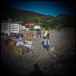 "Residents of Santa Maria bring supplies to the shore for boats to carry to their town because their highway has been blocked due to disputes over the wind farms. Santa Maria and San Mateo are feuding because Santa Maria has agreed to permit the construction of wind farms on disputed territory...The Isthmus of Tehuantapec, long a center for indigenous land ownership, is now embroiled in a land dispute over wind farm land...Called ""Mexico's little waist,"" the Isthmus is a wind tunnel that links the Gulf of Mexico to the Pacific through mountain passes at the narrowest part of Mexico. The geographical funnel makes it one of the windiest places in North America and for a decade wind energy companies have been jostling to acquire land to power the likes of Coca-Cola and Wal Mart."