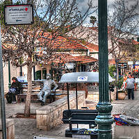 Woman and statue sitting on bench in Zichron Yacov Israel