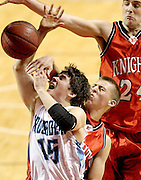 Grand Island Central Catholic's Seth Wardyn (15) is fouled while attempting a basket by Norfolk Catholic's Drew Farlee (5) in the second half during the Heartland Hoops Classic at the Heartland Events Center in Grand Island on Saturday. (Independent/Crystal LoGiudice)